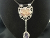 033b-pendant-with-rutilated-quartz-in-prongs-riveted-to-mokume-with-amethyst-hanging